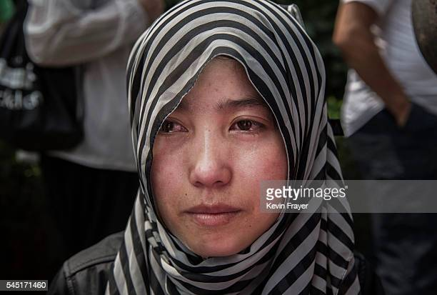 """Chinese Hui Muslim woman weeps as he prays at the """"Sheiks Tombs"""" after Eid al-Fitr prayers marking the end of the holy fasting month of Ramadan at..."""