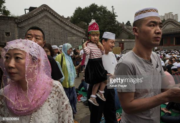 Chinese Hui Muslims arrive as they gather for Eid al-Fitr prayers marking the end of the holy fasting month of Ramadan at the historic Niujie Mosque...