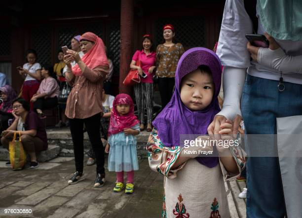 Chinese Hui Muslims gather before Eid al-Fitr prayers marking the end of the holy fasting month of Ramadan at the historic Niujie Mosque on June 16,...