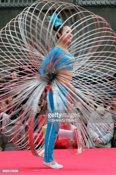 A Chinese hulahooper performs to celebrate Chinese Lunar New Year at Yokohama Chinatown in Yokohama suburban Tokyo on January 29 2017 People...