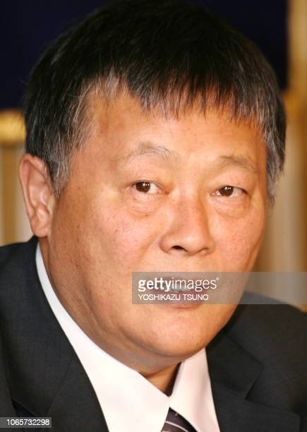 Chinese human rights activist Wei Jinsheng speaks before press in Tokyo 30 October 2006. Wei denounced US internet search giants Yahoo! and Google in...