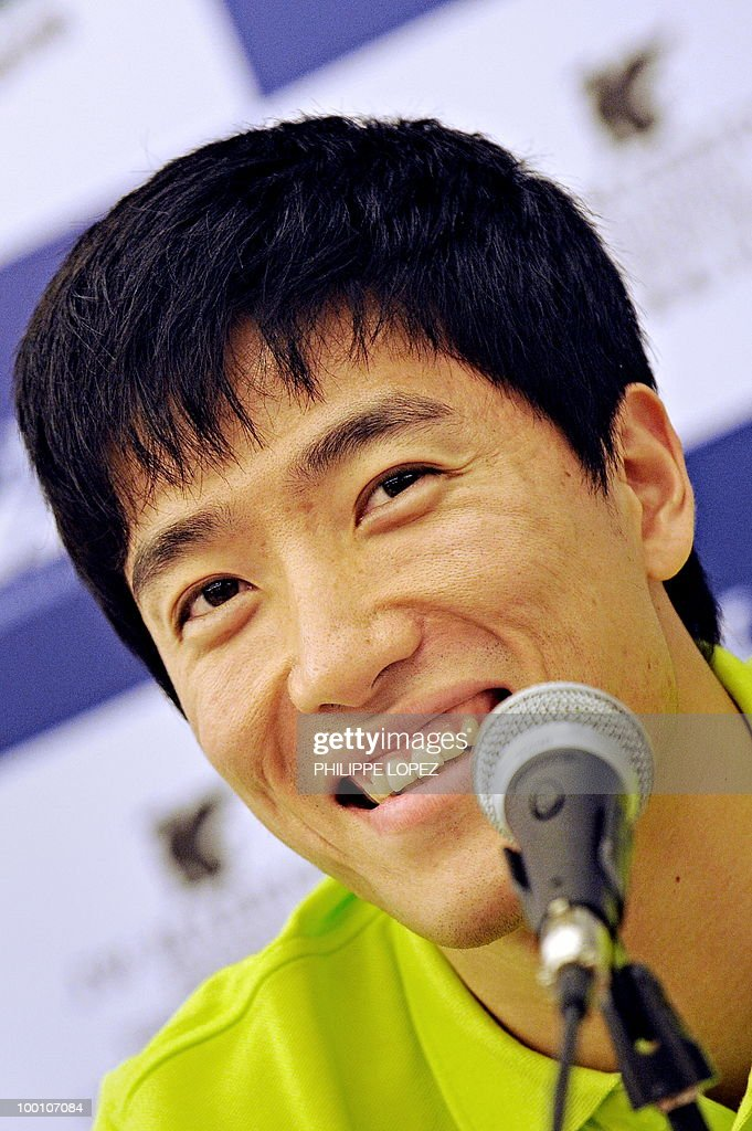 Chinese hurdler Liu Xiang smiles during a press conference ahead of the IAAF Diamond League in Shanghai on May 21, 2010. Jamaican sprinter Usain Bolt returns to China for the first time since his triple-gold Olympic feat to launch his 200-metre season on while Chinese hurdler Liu Xiang looks for redemption in his hometown.