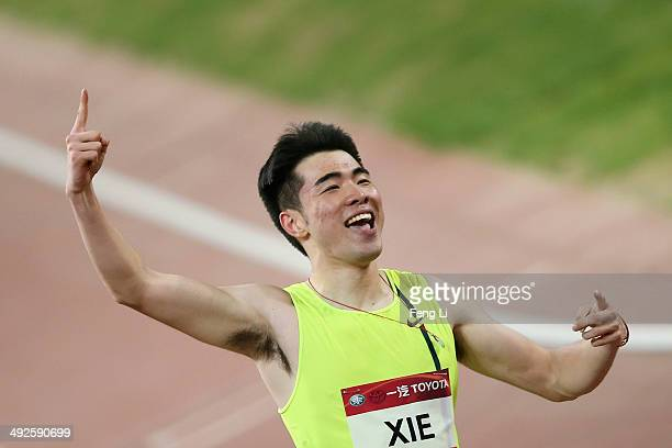 Chinese hurdler Xie Wenjun celebrates winning the men's 110meter hurdles during 2014 IAAF World Challenge Beijing at National Stadium on May 21 2014...