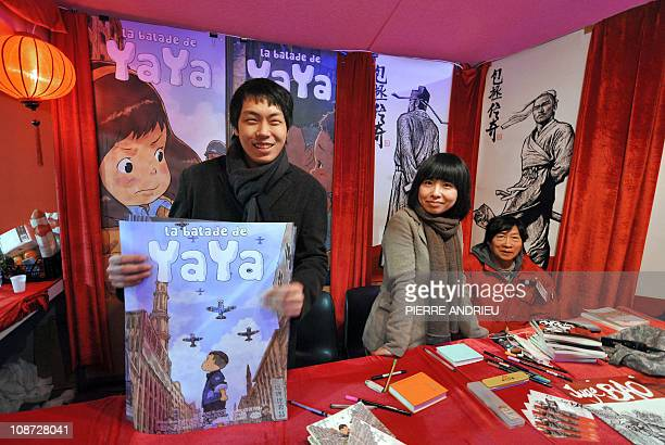 Chinese illustrators Chongrui Nie and Zhao Golo pose with Ge Fei Xu the Chinese founder of Fei a publishing company introducing Chinese stories in...