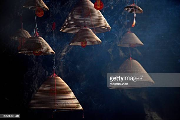 chinese incense coils pattern - incense coils stock photos and pictures