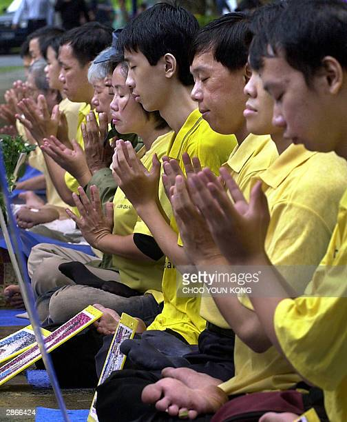 Chinese Indonesian and Indonesian Falun Gong practitioners protest with portraits of victims who died by suppression of Chinese government in front...