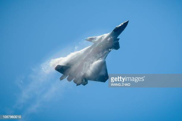 Chinese J20 stealth fighter performs at the Airshow China 2018 in Zhuhai in southern China's Guangdong province on November 6 2018
