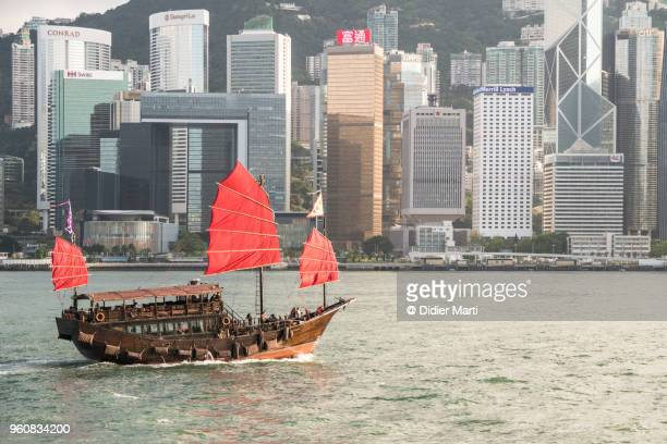 A Chinese junk carries tourist across the famous Victoria harbor in Hong Kong