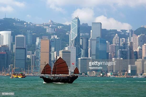 Chinese junkboat sailing across Hong Kong harbor