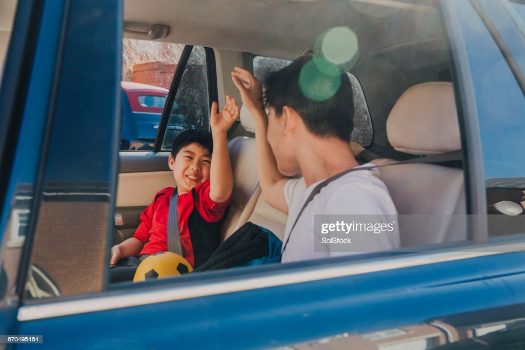 Chinese Kids Laughing in Backseat : Stock Photo
