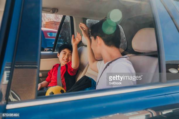 Chinese Kids Laughing in Backseat