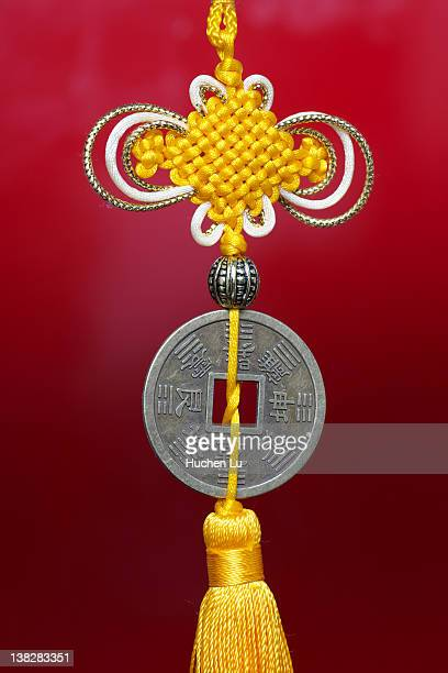 chinese knot and ancient coin - chinese knotting stock pictures, royalty-free photos & images