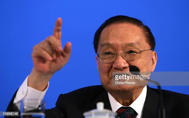 Chinese Kung Fu fiction writer Jin Yong delivers a speech at a symposium at Peking University June 18 2007 in Beijing China Jin born in Zhejiang in...