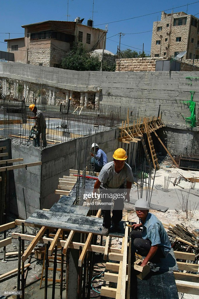 Chinese laborers work on a building site for an extention to the Maale Zeitim (Olive Heights) religious settlement on the Mount of Olives August 18, 2008 in East Jerusalem, Israel. The settlement, an apartment complex which houses dozens of families, is being built with funding from the Florida-based bingo and gambling magnate Irving Moskowitz by the Ateret Cohanim organization, which is dedicated to expanding Jewish settlement in East Jerusalem, the half of the city that Israel captured from Jordan in the 1967 Six Day War.