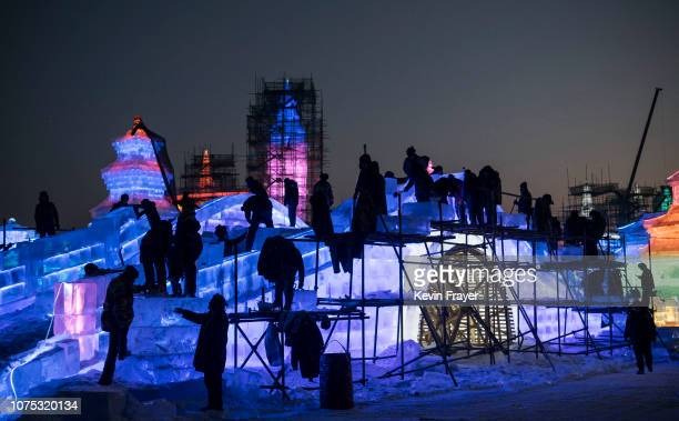 Chinese laborers work on an ice sculpture in preparation for the Harbin Ice and Snow Festival on December 19 2018 in Harbin China The annual winter...