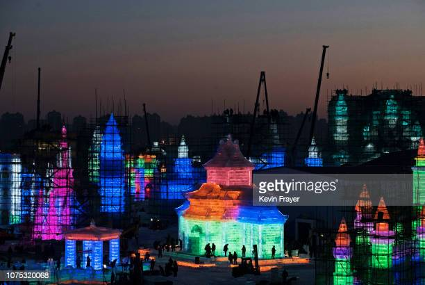 Chinese laborers work on large ice sculptures in preparation for the Harbin Ice and Snow Festival on December 19 2018 in Harbin China The annual...