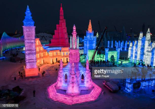 Chinese laborers work to finish large ice sculptures in preparation for the Harbin Ice and Snow Festival on December 22 2018 in Harbin China The...