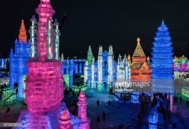 Chinese laborers work to finish large ice sculptures in preparation for the Harbin Ice and Snow Festival on December 22 2018 in Harbin ChinaThe...
