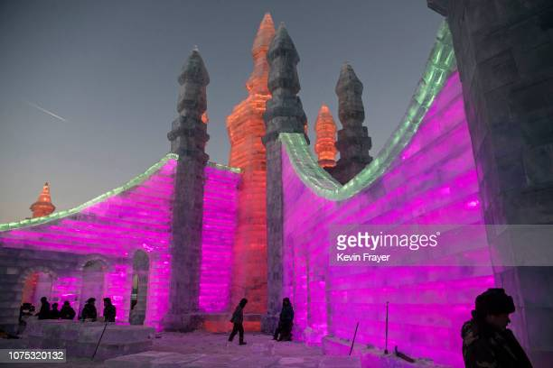 Chinese laborers work to finish large ice sculptures in preparation for the Harbin Ice and Snow Festival on December 20 2018 in Harbin ChinaThe...