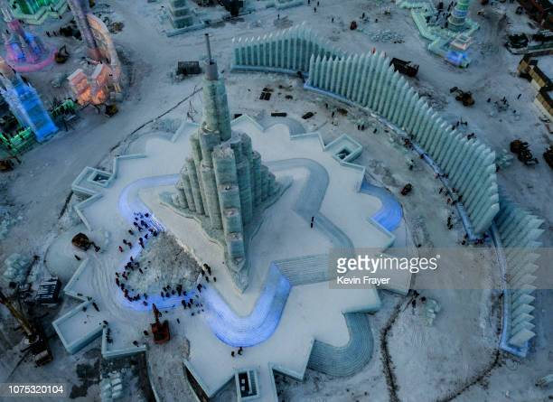 Chinese laborers work to finish the main ice sculpture in preparation for the Harbin Ice and Snow Festival on December 22 2018 in Harbin China The...