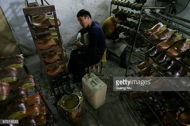 Chinese labourer works at a leather shoe workshop on March 4 2006 in Wenzhou of Zhejiang Province China Wenzhou is one of the major shoe production...