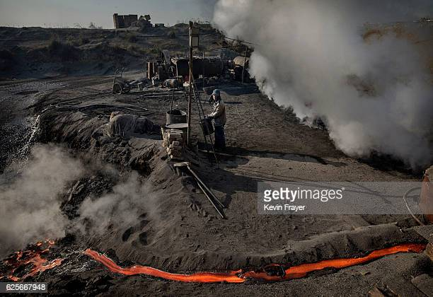 Chinese labourer works at an unauthorized steel factory on November 3 2016 in Inner Mongolia China To meet China's targets to slash emissions of...