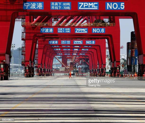 Chinese labourer works at Ningbo Port on June 9, 2005 in Ningbo, Zhejiang province, China. The port was put into use formally in 738 AD. It is one of...