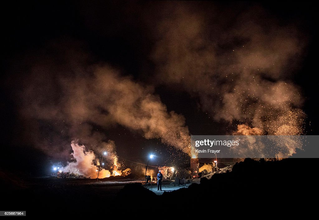 Chinese labourers work as smoke and steam rises from an unauthorized steel factory on November 3, 2016 in Inner Mongolia, China. To meet China's targets to slash emissions of carbon dioxide, authorities are pushing to shut down privately owned steel, coal, and other high-polluting factories scattered across rural areas. In many cases, factory owners say they pay informal 'fines' to local inspectors and then re-open. The enforcement comes as the future of U.S. support for the 2015 Paris Agreement is in question, leaving China poised as an unlikely leader in the international effort against climate change. U.S. president-elect Donald Trump has sent mixed signals about whether he will withdraw the U.S. from commitments to curb greenhouse gases that, according to scientists, are causing the earth's temperature to rise. Trump once declared that the concept of global warming was 'created' by China in order to hurt U.S. manufacturing. China's leadership has stated that any change in U.S. climate policy will not affect its commitment to implement the climate action plan. While the world's biggest polluter, China is also a global leader in establishing renewable energy sources such as wind and solar power.
