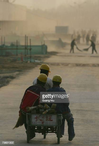 Chinese labourers work at the construction site of the Olympic Green Tennis Center on March 26 2007 in Beijing China The Olympic Green Tennis Center...