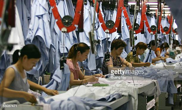 Chinese labourers work at the Youngor Group textile factory on June 8 2005 in Ningbo Zhejiang Province China EU trade chief Peter Mandelson is...