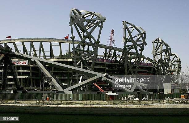 Chinese labourers work on the construction site of the National Olympic Stadium on March 16 2006 in Beijing China The main body of the 2008 Olympic...