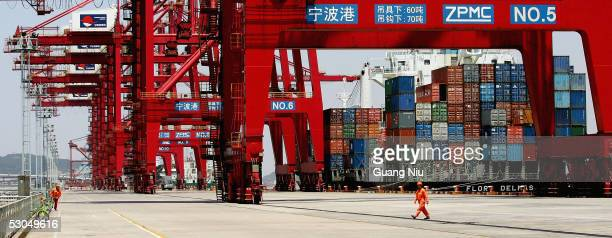 Chinese labourers works at Ningbo Port on June 9 2005 in Ningbo Zhejiang province China The port was put into use formally in 738 AD It is one of...
