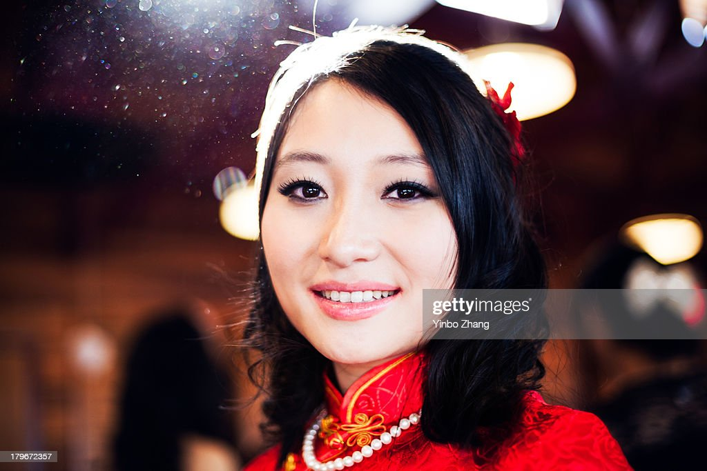 Chinese lady in a red dress : Stock Photo