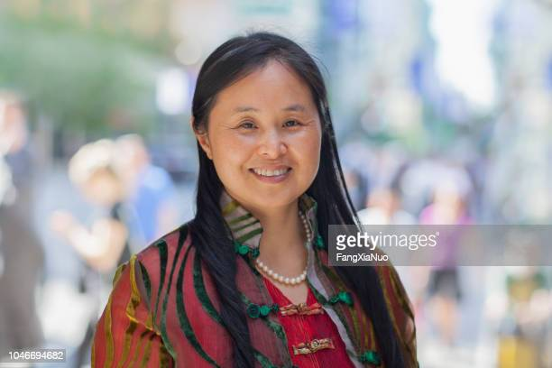 chinese lady in traditional clothing street portrait - indigenous culture stock pictures, royalty-free photos & images