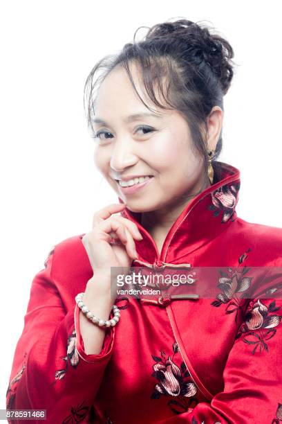 Chinese lady wearing a red cheongsam