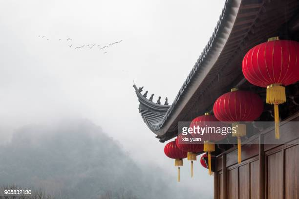 Chinese Lantern Hanging By Roof Against Misty Mountains,Hangzhou,China