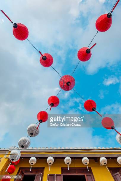 chinese lanterns against the blue sky in hoi an, vietnam - x art photos et images de collection