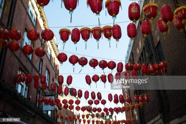 Chinese lanterns hang above a street in Chinatown ahead of Chinese New Year tomorrow on February 15 2018 in London England Chinese New Year The Year...