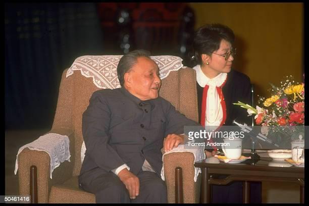 Chinese ldr. Deng Xiaoping during mtg. W. US NSC Adviser , w. Prob. Interpreter sitting behing him.