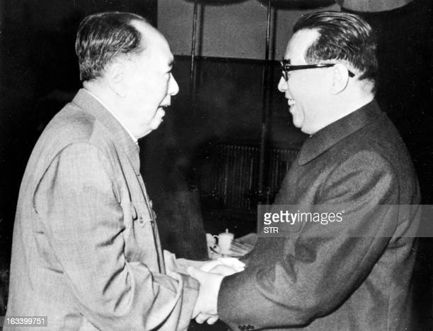 Chinese leader Mao Tse Tung shown in undated photo greeting North Korean President Kim Il Sung in Beijing during an official visit where Kim met high...