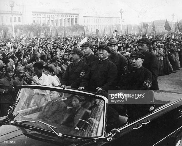 Chinese leader Mao Tse-tung , accompanied by his second-in-command Lin Biao , passes along the ranks of revolutionaries during a rally in Tiananmen...