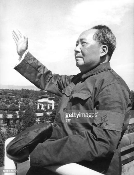 "Chinese leader Mao Zedong reviewing for the first time the army forces of the ""Great Proletarian Cultural Revolution"" on the Tienanmen Gate rostrum..."