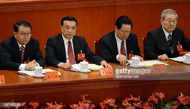 Chinese leaders Li Changchun Vice Premier Li Keqiang security chief Zhou Yongkang and former premier Zhu Rongji attend the opening of the 18th...