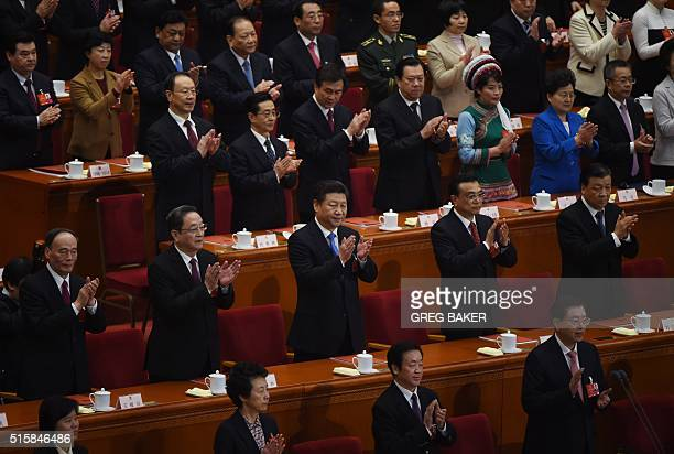 Chinese leaders second row from left Wang Qishan a member of the Standing Committee of the Political Bureau of the Communist Party of China Central...