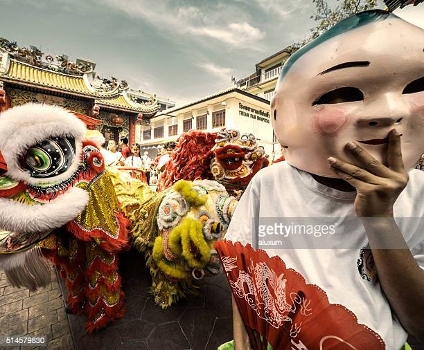 chinese lion dance new year chinatown bangkok thailand - chinese mask stock photos and pictures