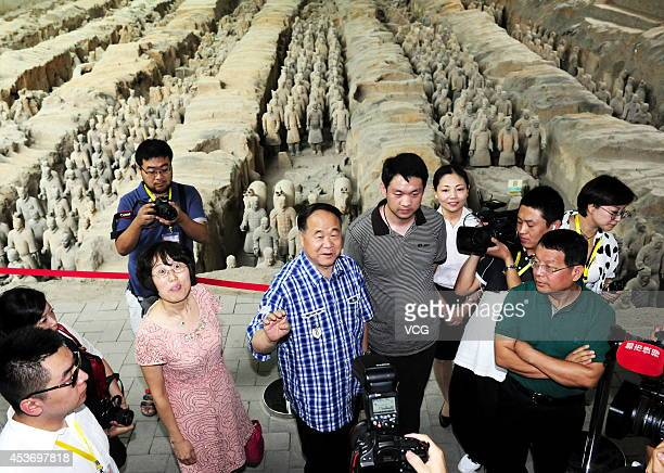 Chinese Literature Nobel laureate Mo Yan visits the terra-cotta warriors on August 16, 2014 in Xi'an, Shannxi Province of China. French Literature...