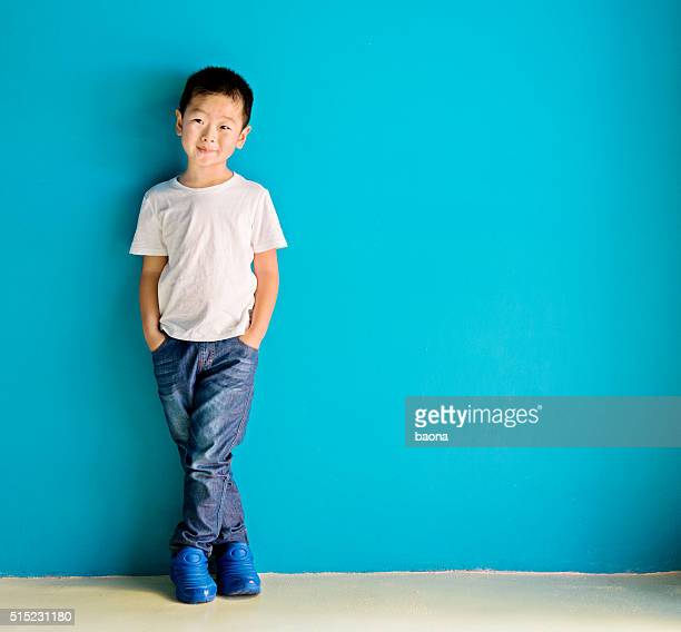 Chinese little boy against wall