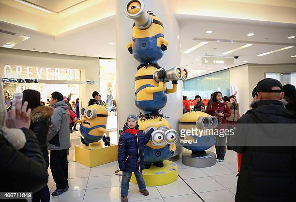 Chinese little boy poses with minions in a shopping mall on the fourth day of the Chinese Lunar New Year of Horse on February 3 2014 in Beijing China...