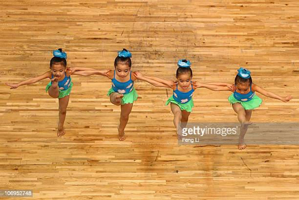 Chinese little girls perform dancing at break during day six of the 16th Asian Games Guangzhou 2010 at Dongguan Gymnasium on November 18, 2010 in...