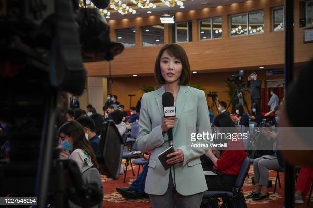 Chinese local media broadcast live before the press conference of Chinese Prime Minister Li Keqiang from The Great Hall Of The People at the end of...